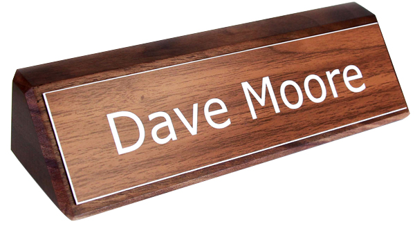 Your engraved nameplate sits proudly on your desk or office.